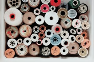 different shape bobbins photographed from above