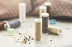 different bobbins and needles