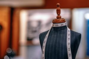 mannequin with measuring tape in a tailor shop