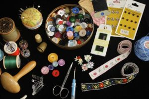 numerous assorted sewing accessories laying