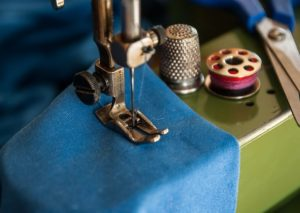 presser foot on the cloth being stitched